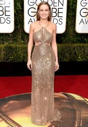 Brie Larson In Calvin Klein Collection dress, Salvatore Ferragamo shoes, and Tiffany & Co. jewelry.