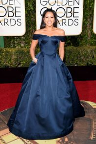Gina Rodriquez In Zac Posen dress and Jimmy Choo clutch.