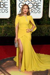 Jennifer Lopez In Giambattista Valli dress, Judith Leiber clutch, Jimmy Choo shoes, and Harry Winston jewelry.