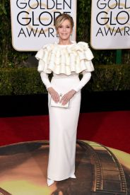 Jane Fonda In Yves Saint Laurent Couture dress, Jimmy Choo shoes, Charlotte Olympia clutch, and Chopard jewelry.