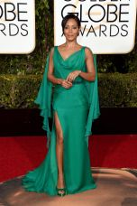 Jada Pinkett Smith In Versace dress and Jimmy Choo shoes.